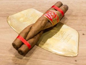 A Partagas Culebra with ribbon and label.